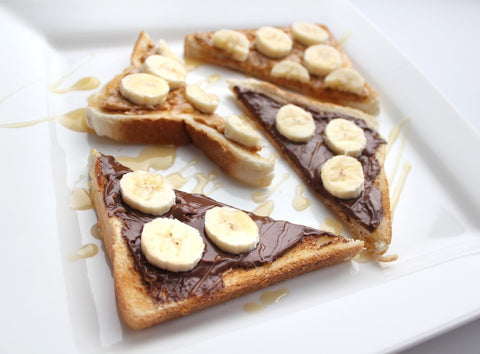 Toast Spread with Nutella and peanut butter topped with banana slices