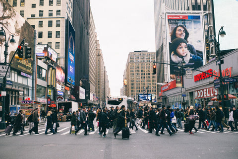 Downtown of the city with people rushing walking around