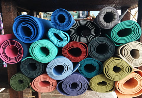 Pile of rolled up yoga mats