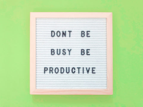 """""""Don't be busy be productive"""" spelt out on board"""