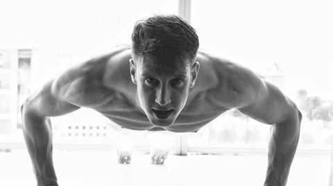 Man Doing a Pushup after Supplementing with Glutamine