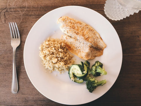 Quinoa, grilled chicken, and broccoli on plate