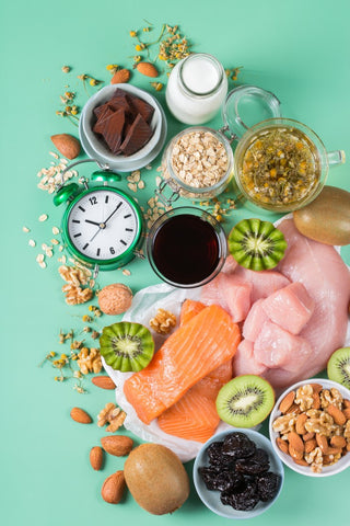 Pile of vitamin rich foods such as proteins, grains, and fruits