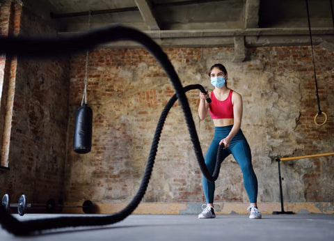 Woman doing rope exercise with mask on