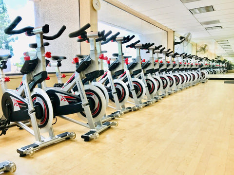 Row of stationary bikes in cycling studio