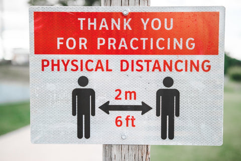 Social Distance sign with two people and arrow telling them to stand 6ft apart