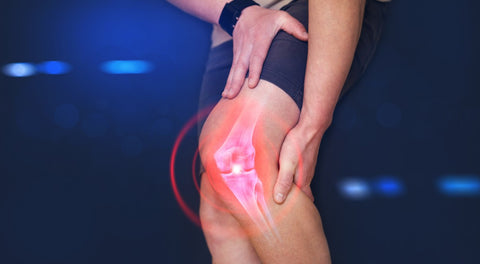 man grabbing animated inflamed knee