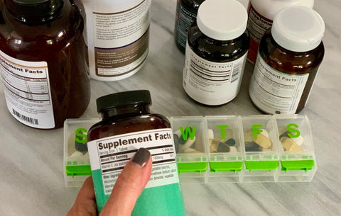 Woman looking at supplement ingredients.