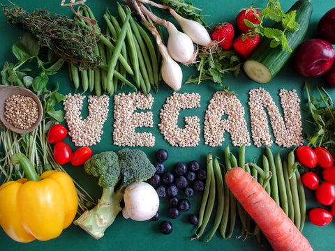 """""""VEGAN"""" spelt out in beans with vegetables around it"""