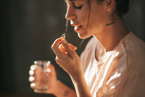 Woman taking an amino acid supplement.