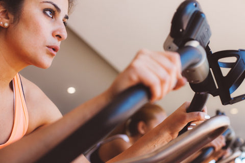 Woman on elliptical looking off into distance
