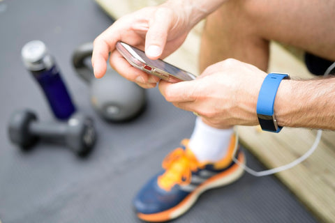 Man on workout app on phone while working out