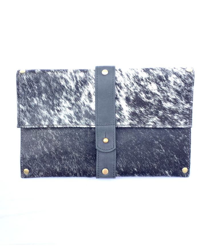 Purposeful cowhide clutch with black and hair with black finished leather accents