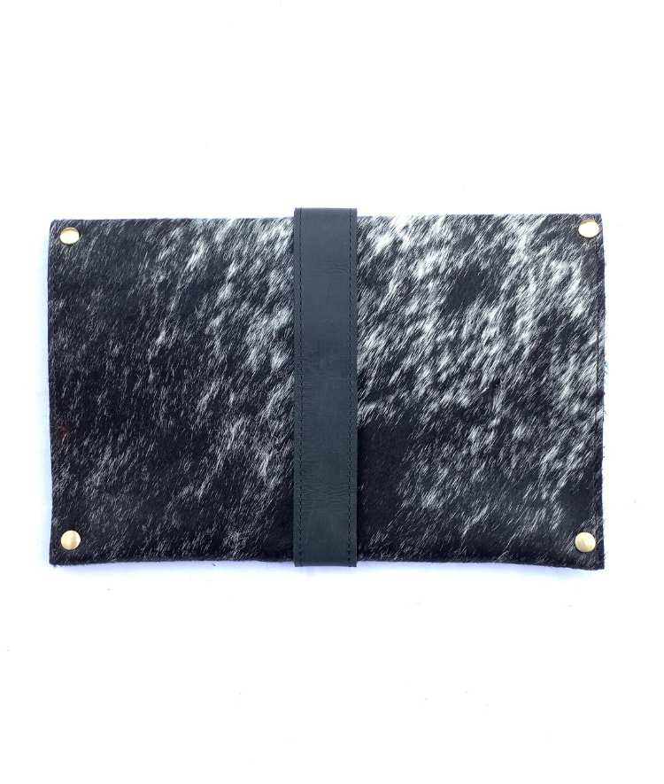 Back of artisan made cowhide clutch with black and hair with black finished leather accents