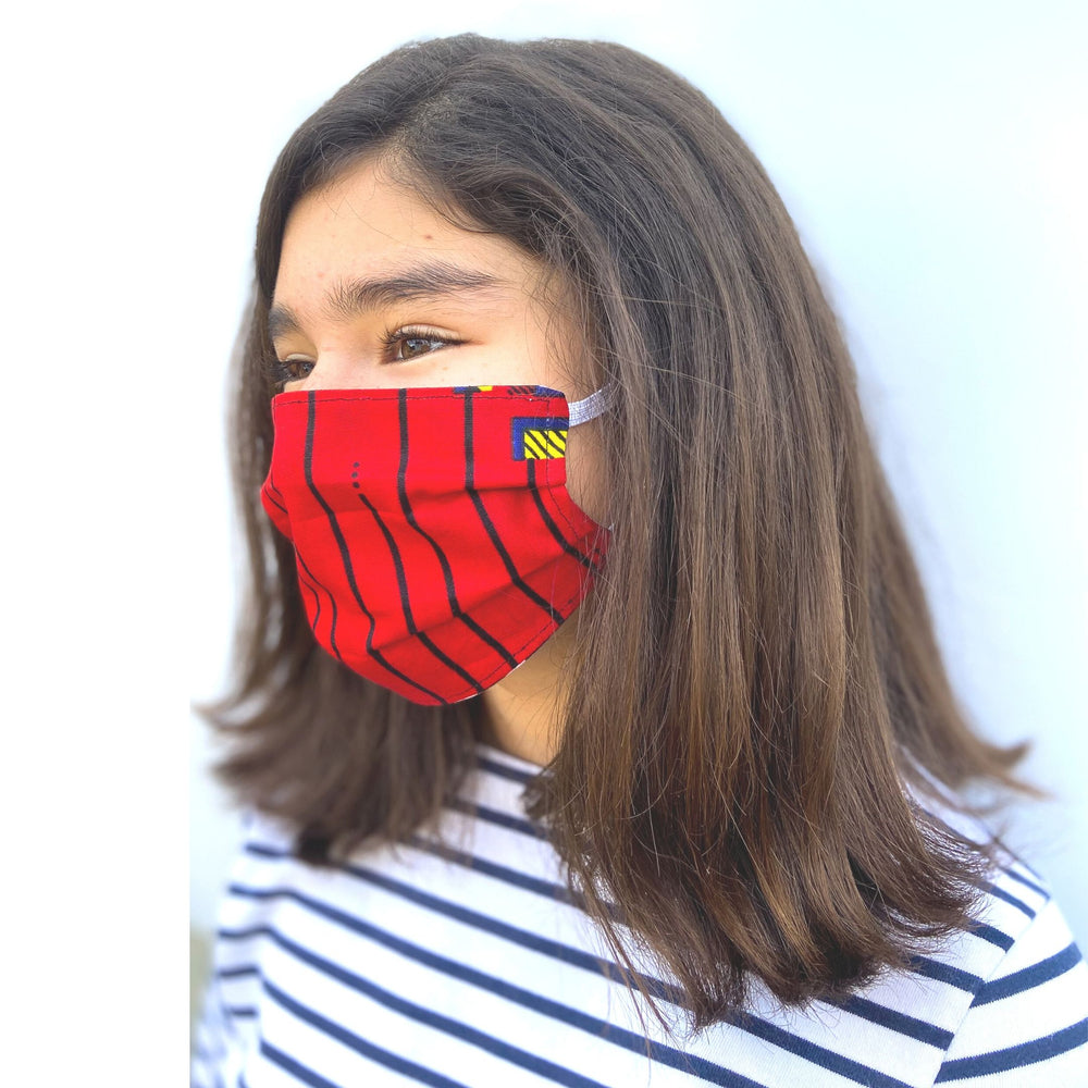 Kid's African fabric surgical mask that gives back in red, from a different angle