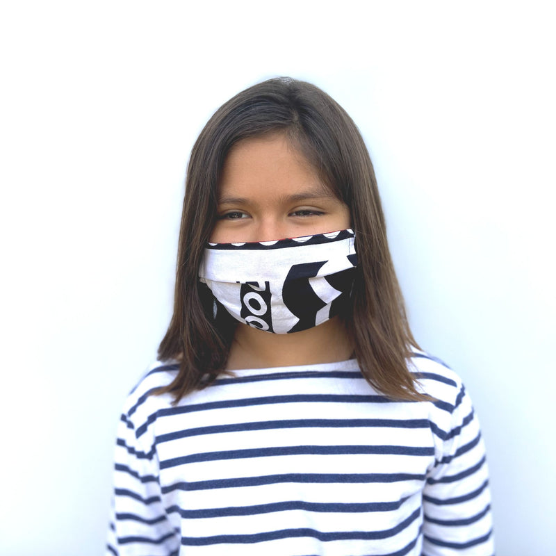 Kid's African fabric surgical mask with a cause in white and black