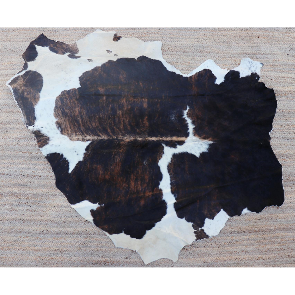 A dark brown and white cowhide rug from Kenya