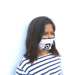 Kid's African fabric surgical mask with a cause in white and black, from a different angle