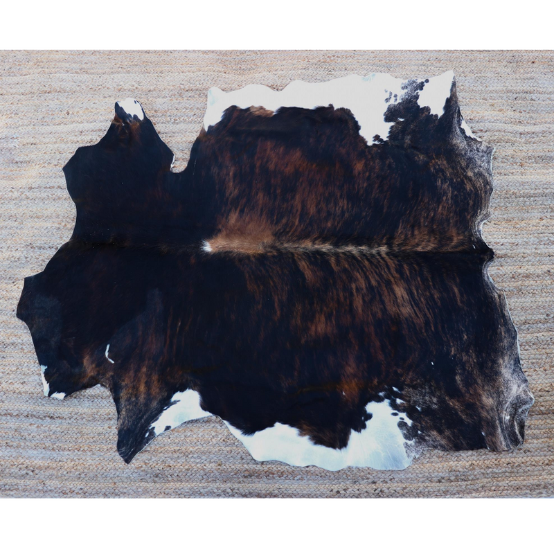 A Brindle and white cowhide rug that comes from Kenya
