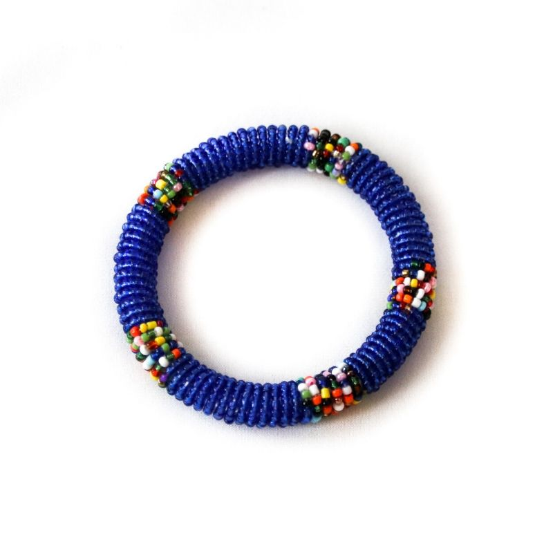 One ethical blue beaded small bangle against a white background