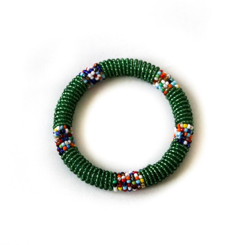 One handmade green beaded small bangle on a white background