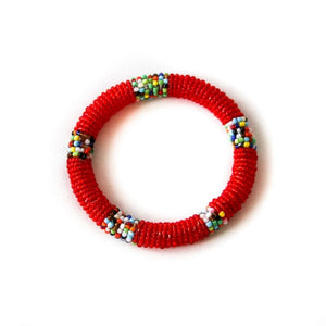 One impactful, Kenyan red small bangle with multicolored accents against a white background