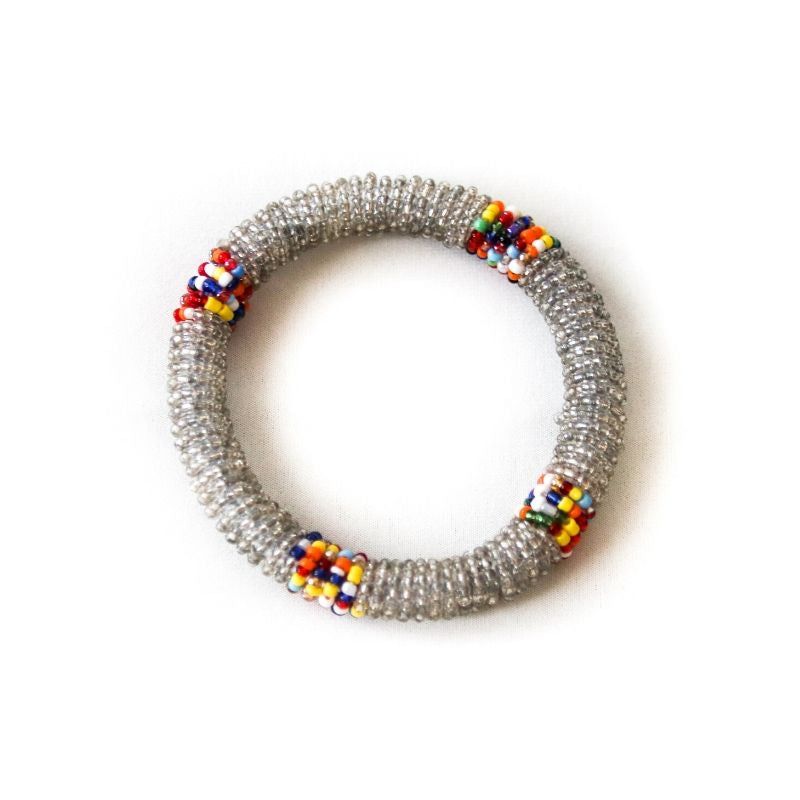 One single silver beaded small bangle with multicolored accents against a white background
