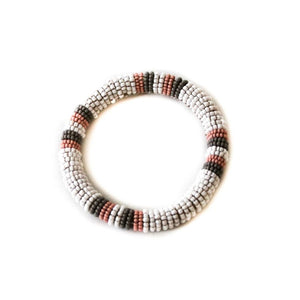Ethical, beaded white small bangle bracelet with pink and grey accents