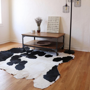 A Kenyan black and white cowhide rug in a room