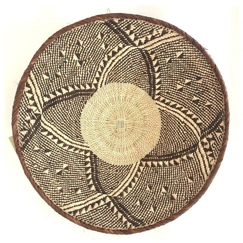 A Zimbabwean Fair Trade Binga Basket with a floral type pattern against a white background