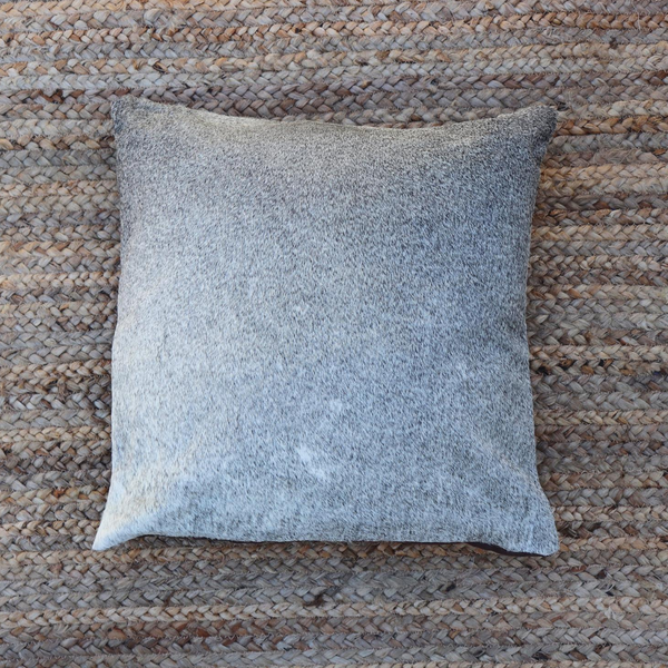 A handmade Kenyan grey cowhide pillow