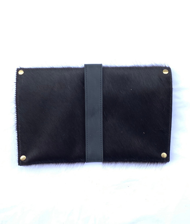 Back of artisan made cowhide clutch in all black hair with black finished leather accents