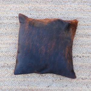A brown and black brindle cowhide accent pillow handmade in Kenya