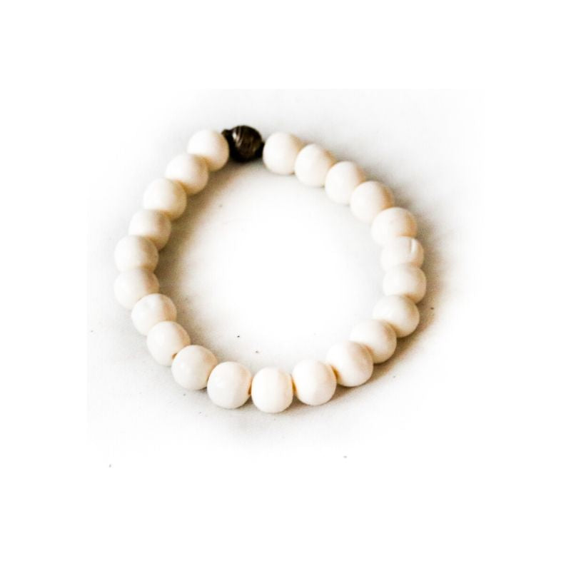 Sustainable and handmade cow bone bracelet with elastic against a white background