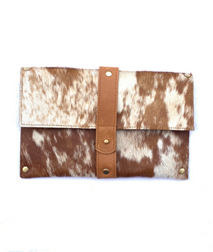 Purposeful cowhide clutch with tan and white hide and tan finished leather accents