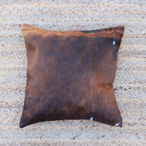 A brown and black brindle cowhide decorative pillow handmade in Kenya