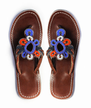 A pair of blue, orange and white beaded leather sandals ethically handmade in Kenya