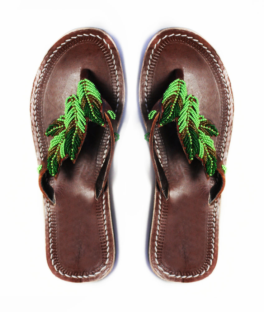 Green handmade and ethical beaded leather sandals with a beaded leaf design
