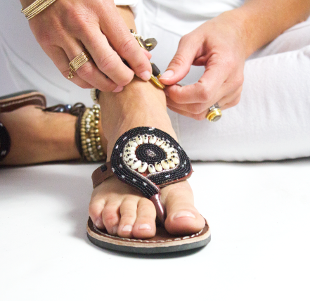 Handmade black beaded Kenyan sandals creating meaningful impact