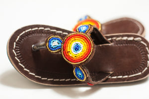 A pair of handmade Kid's sized multicolored beaded sandals