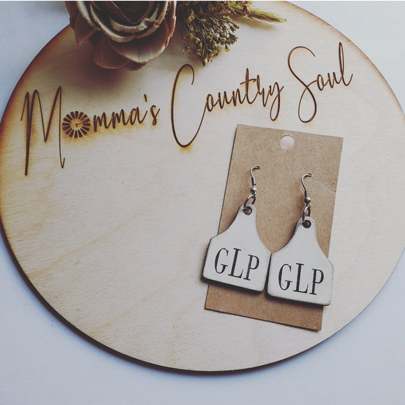 Monogram cow tag earrings