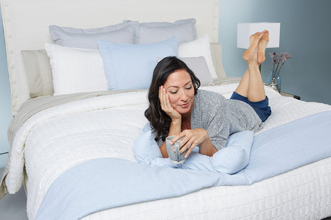 Woman on Bed in Guest Room