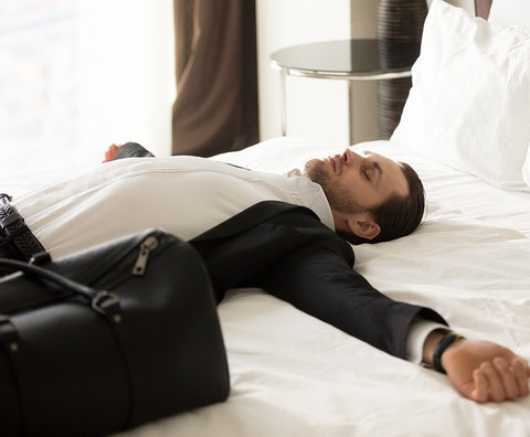 man laying on hotel mattress