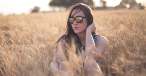 Girl wearing mirrored sunglasses