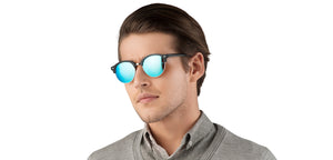 Man wearing a shirt wearing Glassic Harper sunglasses
