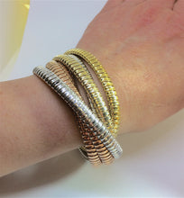 Multi Strand Rolling Bracelet wore by Italian Woman Designed by Carlo Weingrill, the highest luxury brand for Tubogas jewels
