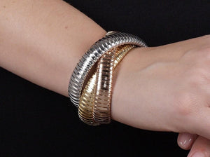 Three Color Gold original Rolling Bracelet worn by woman on wrist