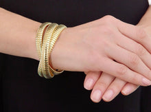 Rolling Bracelet in Yellow Gold the Original made in Italy worn on wrist