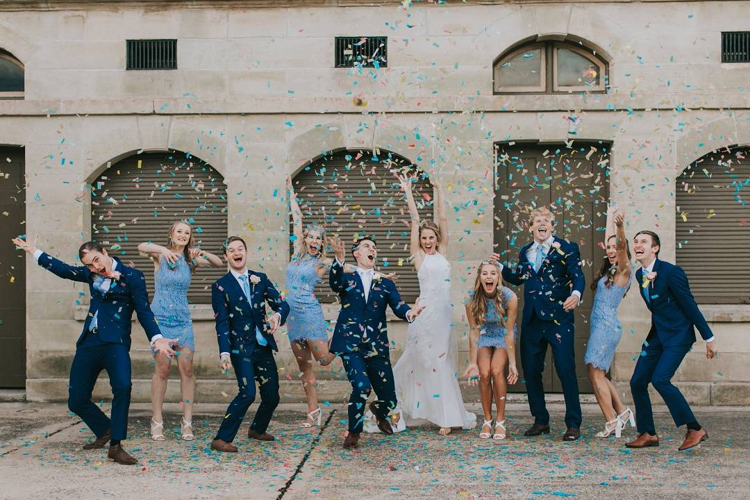 Bioconfetti Bridal Party throwing Confetti in front of building