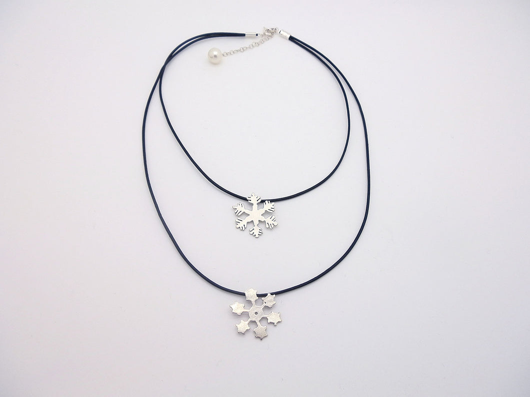 Handmade Snowflakes Hanging On Black Leather Cord Of Two Layers With A Pearl